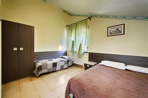 Кровать или кровати в номере Albergo Mancuso del Voison