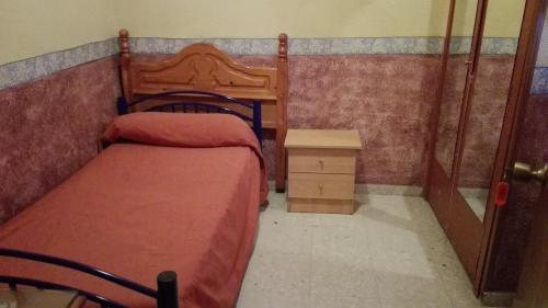 A bed or beds in a room at Hospedería Lucano