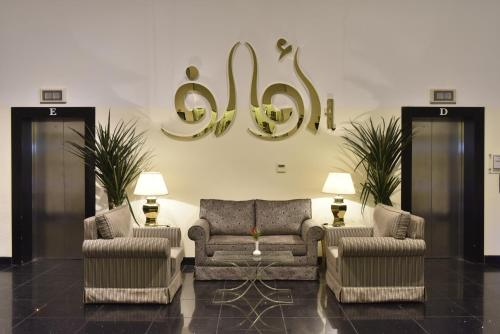A seating area at Awaliv International Hotel