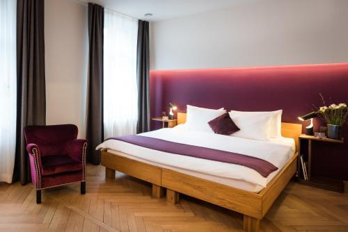 Ein Bett oder Betten in einem Zimmer der Unterkunft Boutique Hotel NI-MO