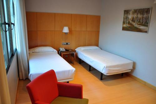A bed or beds in a room at Hotel Feria