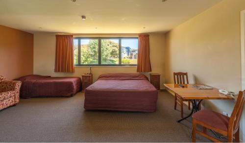 Säng eller sängar i ett rum på Waterfront motel