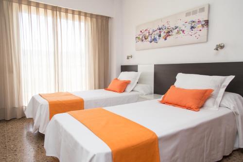 Cama o camas de una habitación en Pio XII Apartments Valencia