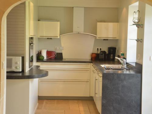 A kitchen or kitchenette at Spacious Villa in Normandy countryside with garden