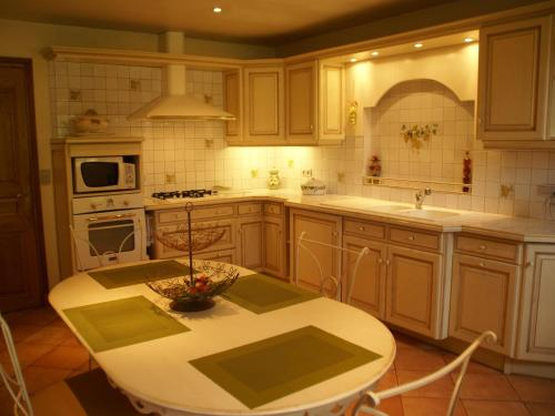 A kitchen or kitchenette at Luxurious Holiday Home in Domme with Swimming Pool