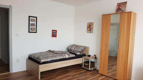 Ein Bett oder Betten in einem Zimmer der Unterkunft Messe Apartment Nürnberg