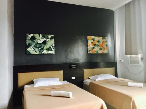A bed or beds in a room at LEUX Hotel