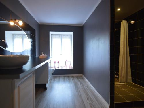A bathroom at Nice Holiday Home in Osmanville Normandy with Terrace