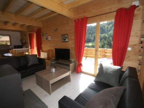 A seating area at Sunlit Chalet near Ski Area in Gerardmer