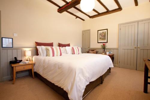 A bed or beds in a room at Mistley Thorn Hotel