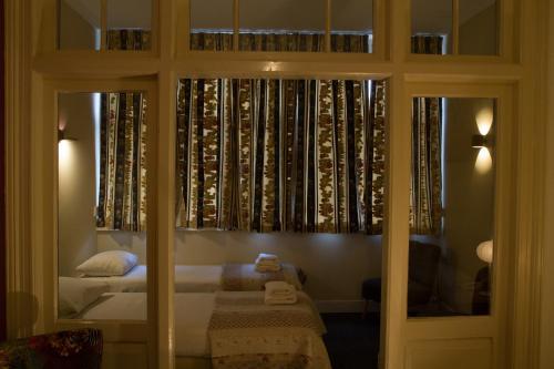 Ein Bett oder Betten in einem Zimmer der Unterkunft Hotel Verdi