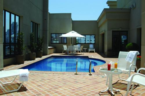 The swimming pool at or near George V Residence Casa Branca