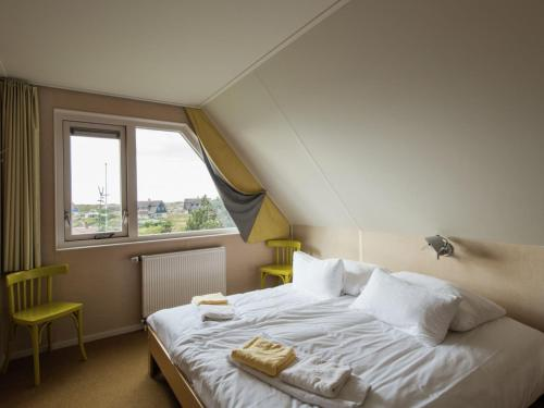 A bed or beds in a room at Boutique Villa in Vlieland with Sauna