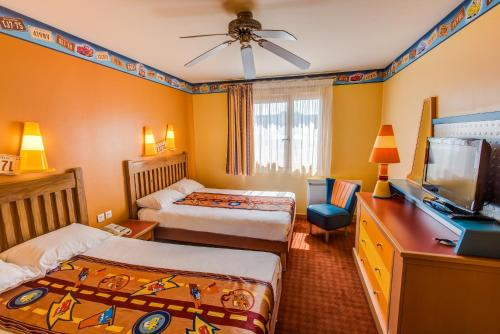 A bed or beds in a room at Disney's Hotel Santa Fe®