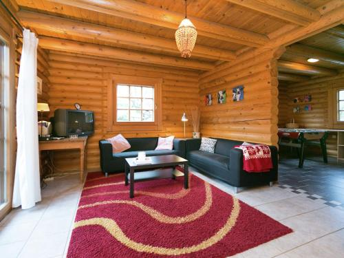 Ein Sitzbereich in der Unterkunft Vintage Chalet in Liebenscheid near the Forest