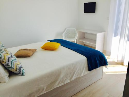Uma cama ou camas num quarto em Gabana Baleal Beach