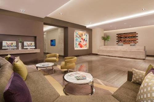 The lobby or reception area at Citadines Salcedo Makati