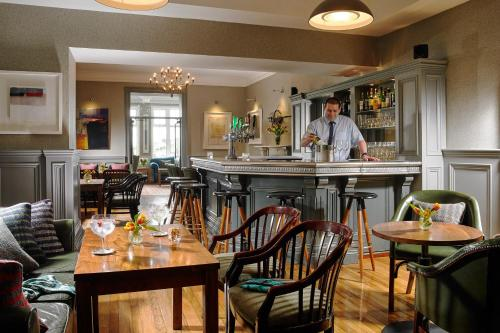 A restaurant or other place to eat at Dunmore House Hotel