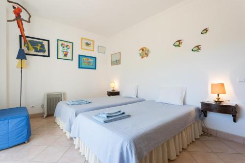 A bed or beds in a room at Feels Like Home - Carrapateira Summer Place