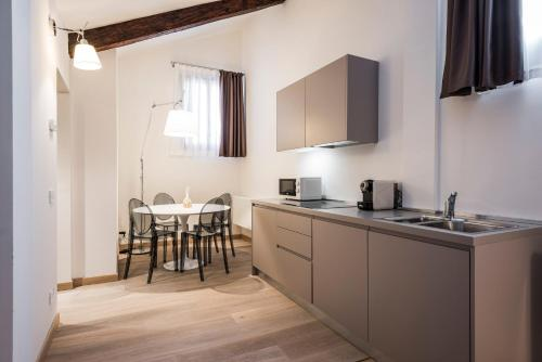A kitchen or kitchenette at MyPlace Campo Santa Margherita Apartments