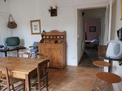 A seating area at Rustic Holiday Home inGray Franche-Comte with Garden