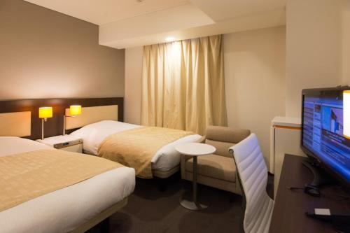 Tempat tidur dalam kamar di Hotel Gracery Sapporo