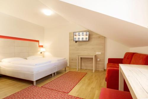 Cama o camas de una habitación en Hotel Eder
