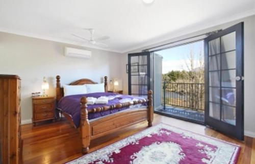 A bed or beds in a room at River Verse - On the Ovens