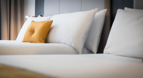 A bed or beds in a room at Maldron Hotel Dublin Airport