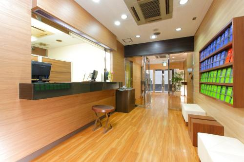 The lobby or reception area at FLEXSTAY INN Sugamo