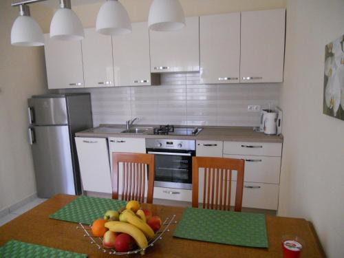 A kitchen or kitchenette at Apartments Mihalić