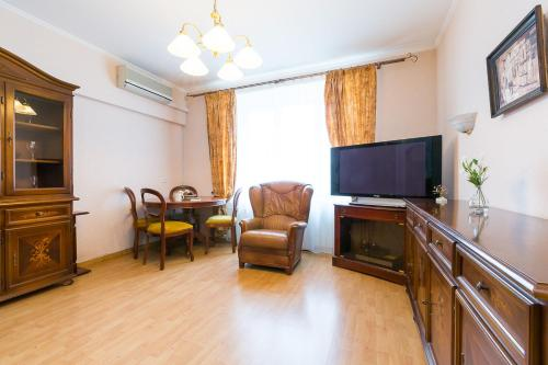 Телевизор и/или развлекательный центр в Stylish Europa near Moscow City