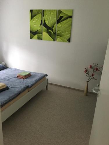 Ein Bett oder Betten in einem Zimmer der Unterkunft Ferienhaus Charme