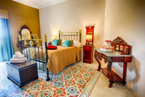 A bed or beds in a room at Casa Gemelli Boutique Guesthouse