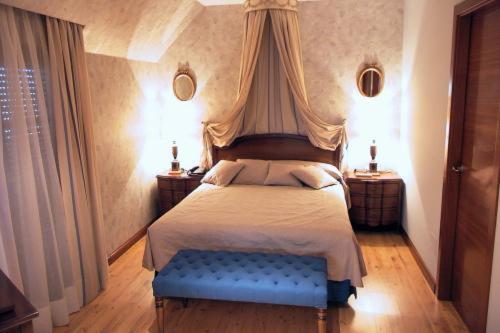 Cama o camas de una habitación en Hotel Santiago