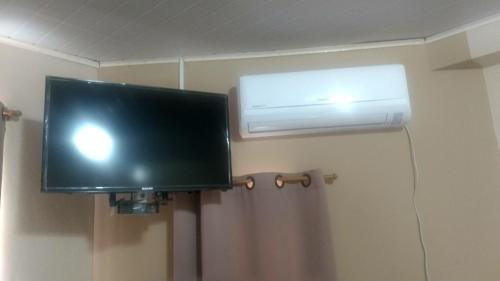 A television and/or entertainment center at Hotel Dom Daniel
