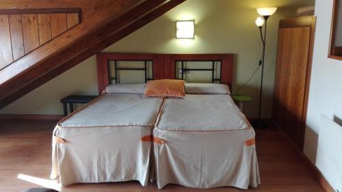 Cama o camas de una habitación en Apartamentos Santana