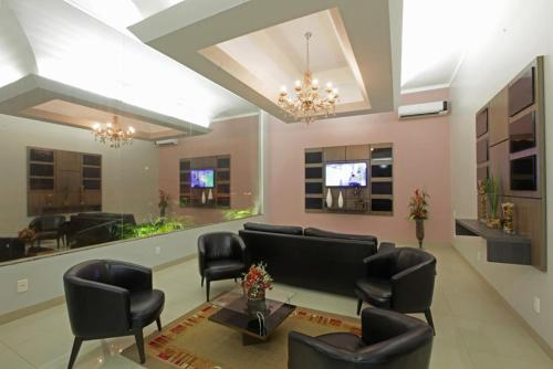 The lobby or reception area at Augustu's Hotel