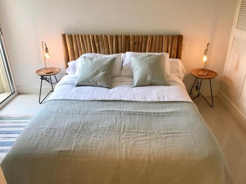 A bed or beds in a room at St Tropez-Ramatuelle Appartement vue mer