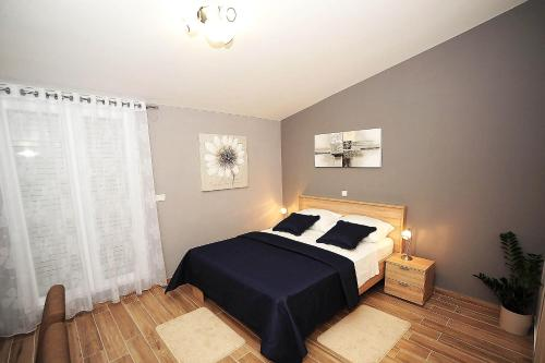 A bed or beds in a room at Top Center Zadar Studio Apartments