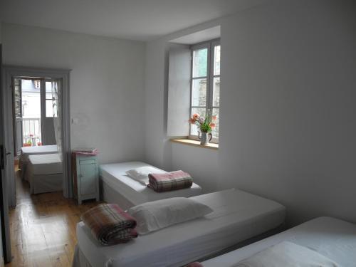 Un ou plusieurs lits dans un hébergement de l'établissement Gite d'etape le Regain