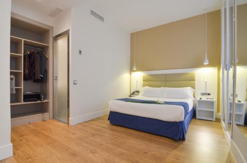 Cama o camas de una habitación en Hotel Miau