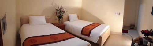 A bed or beds in a room at Sapa Paramount Hotel
