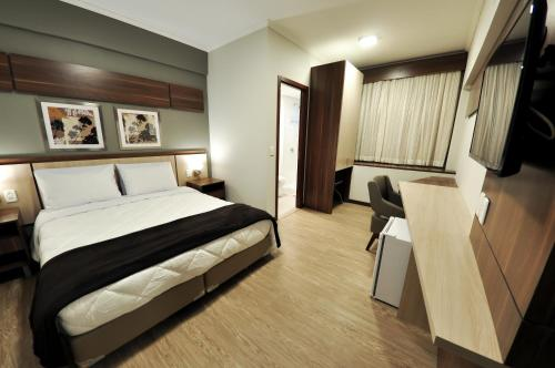 A bed or beds in a room at Klein Ville São Leopoldo