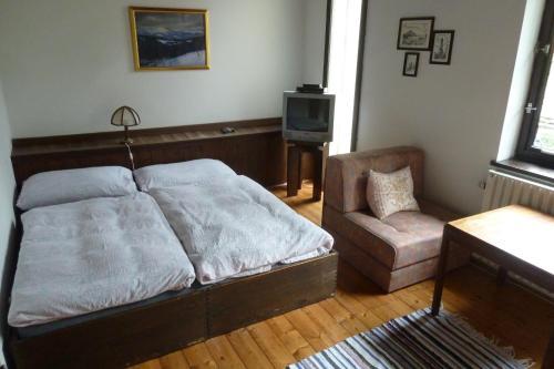 Postel nebo postele na pokoji v ubytování Penzion Sport Čermák