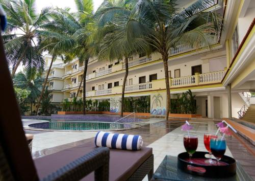 The swimming pool at or near Sterling Goa Varca
