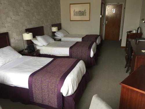 A bed or beds in a room at The Shetland Hotel