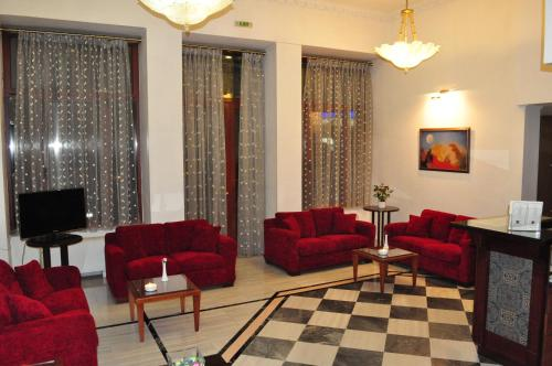 Кът за сядане в Hotel Acropole