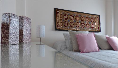 A bed or beds in a room at Precioso Atico con Vistas en el Centro de Santa Cruz