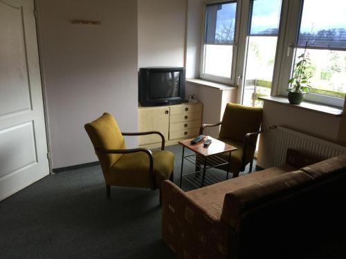 Ein Sitzbereich in der Unterkunft Pensjonat Pelikan